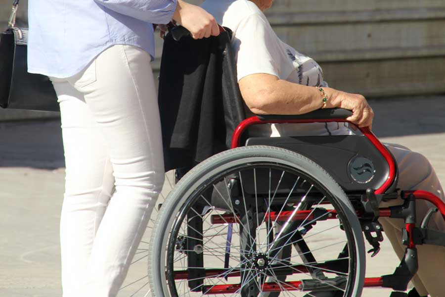 Person Being Pushed in Wheelchair